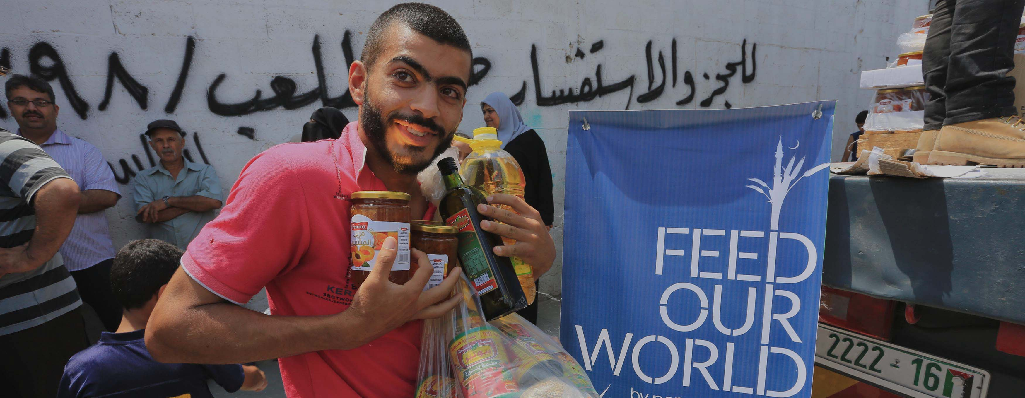 Palestinian with food provided by PennyAppeal