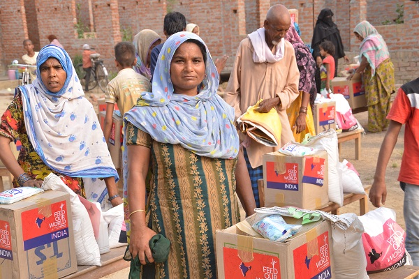 Village women with food aid package