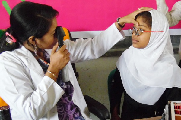 Eye test and healthcare, young girls eyesight