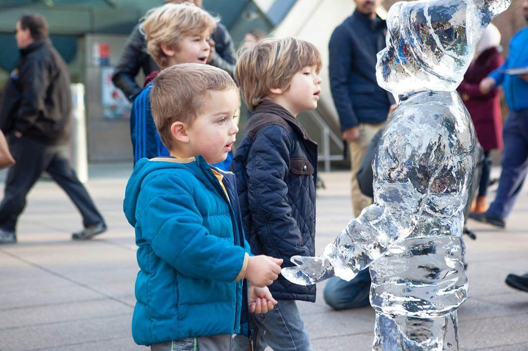 Children playing with Ice Sculptures