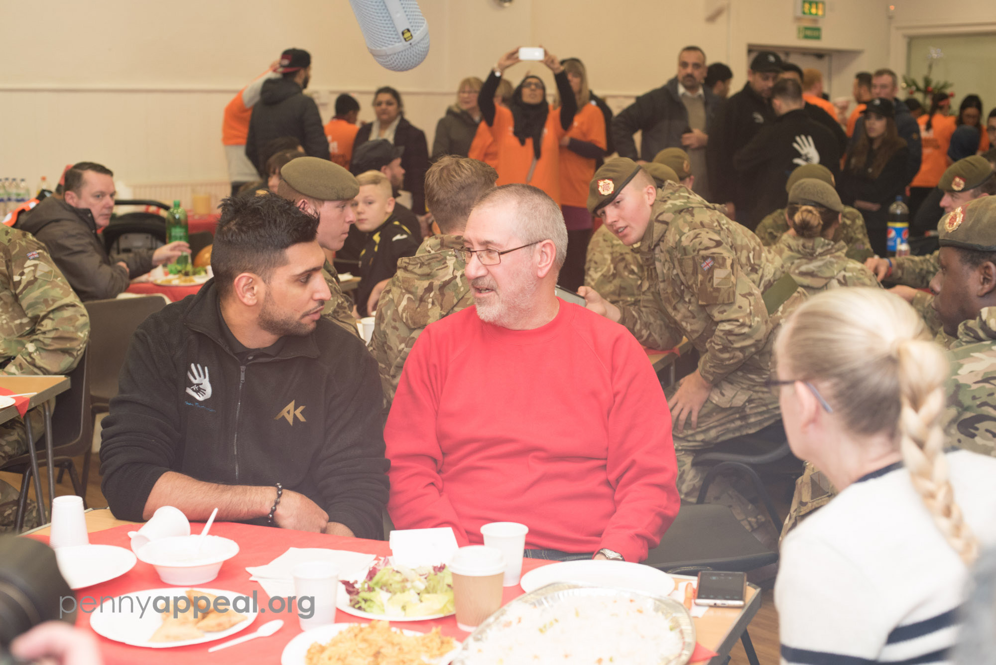Amir Khan with flood victims in Carlisle